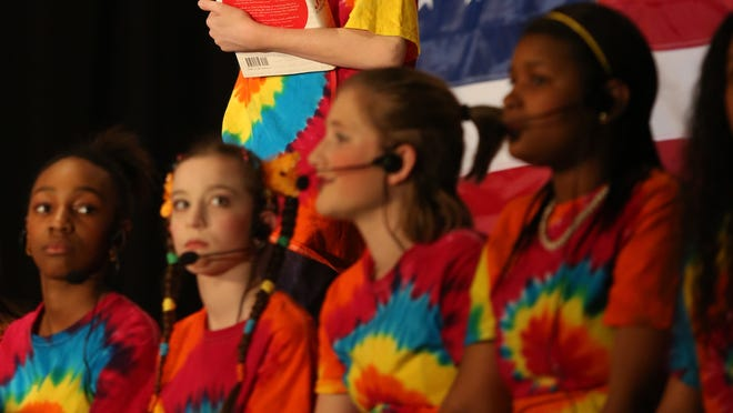 """Alexander Kress performs during the song, """"Great American Melting Pot"""" in the Winton Woods Middle School Massability production of School House Rock Live, Jr."""