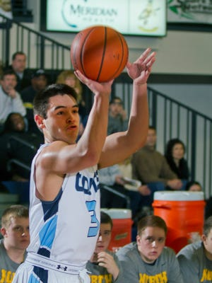 CBA's John Salcedo drops in a three point shot during first half action. Toms River North vs Christan Brothers Academy Boys Basketball during  Shore Conference Tournament Semifinal in Middletown NJ  on  February, 25, 2015.  Peter Ackerman/Staff Photographer