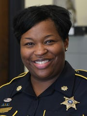Makesha Harris of the Bossier Parish Sheriffs Office works with inmates attending a substance abuse treatment program.
