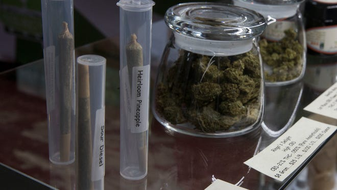 Marijuana products, including pre-rolled cigarettes and buds are displayed at the medical marijuana dispensary owned by Tim Blake near Laytonville, Calif., in 2016. The Florida Legislatureearlier this month passed Senate Bill 8A, which trumps local laws that cities and counties have imposed to regulate where and how medical marijuana dispensaries can operate.