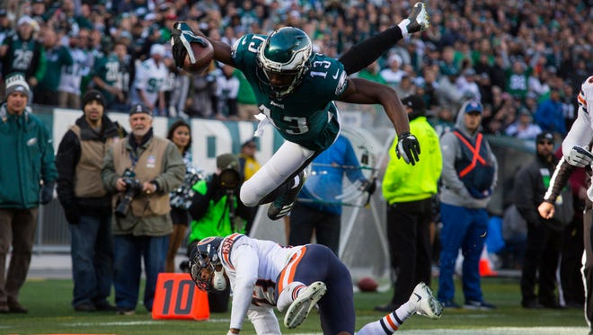 Eagles' Nelson Agholor flips over Chicago's Kyle Fuller to score Sunday at Lincoln Financial Field.