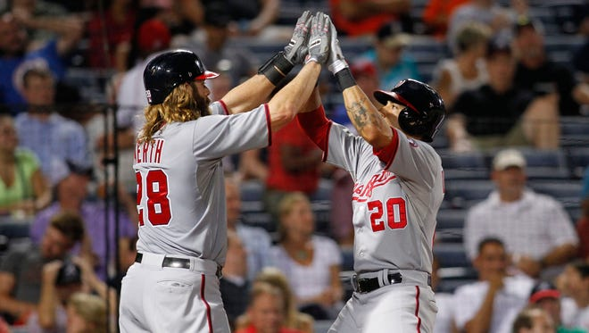 Jayson Werth congratulates shortstop Ian Desmond after Desmond's two-run homer gave the Nationals the lead Tuesday.