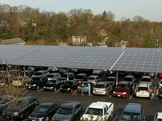 A large solar panel hangs over the parking area at the Cincinnati Zoo and Botanical Garden.