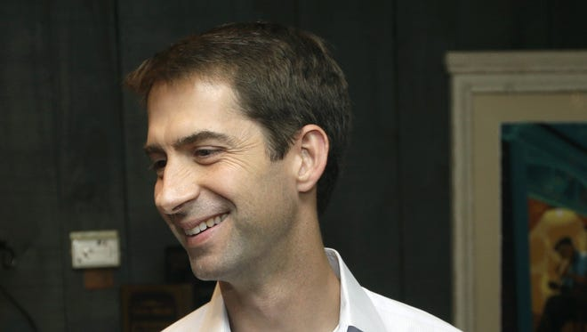 Republican Rep. Tom Cotton greets supporters during a fund-raising event in Little Rock, Ark., on Aug. 7, 2014.