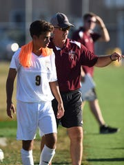 Arlington boys soccer head coach, Craig Sanborn, gives instructions to midfielder Anthony Germano during the Admirals' Sept. 22 game against John Jay at Arlington High School.
