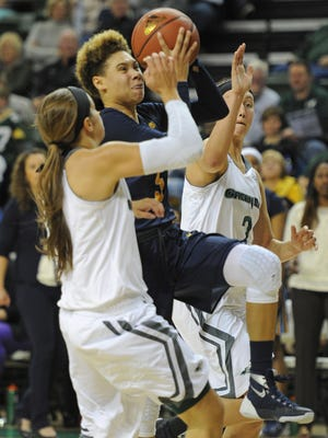 Marquette University freshman and Green Bay Southwest alumna Natisha Hiedeman (5) was named to the Big East Conference all-rookie team for women's basketball on Wednesday.