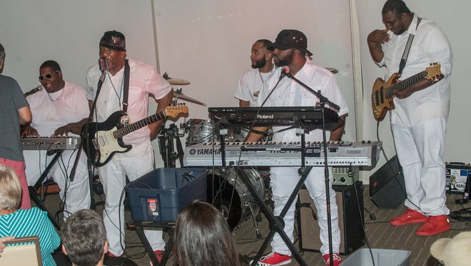 The group Funk Nation is one of five bands that played in downtown Montgomery's skyline on Saturday, July 15, 2017, during the fourth annual MAMA over Montgomery on top of RSA Tower.