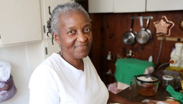Joyce Edwards holds a glass of juice made out of carrots, spinach and an apple in her Cincinnati home on Aug.  19, 2013. Edwards, 68, once weighed 25 pounds more and had to take medicine to control high blood pressure. She researched and, even into her 50s, changed her diet to reduce meat and traditional soul food, increase vegetables, and limit salt and sweets. She started to walk at least three times a week.  Edwards no longer needs medication and is in the best health of her life.