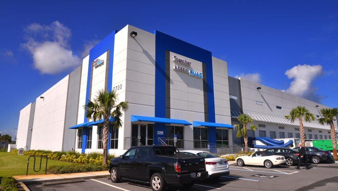 Port Canaveral commissioners have approved the sale of the port's Logistics Center in Titusville for $17.5 million.