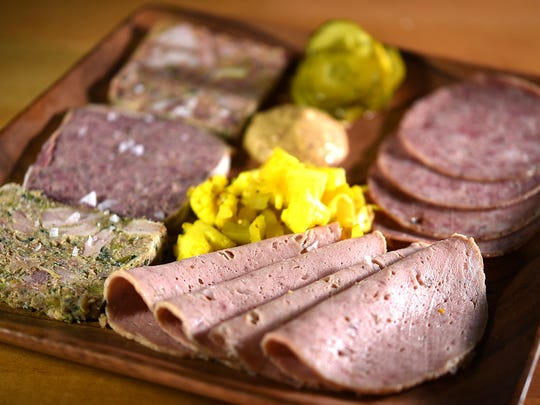 The charcuterie plate at Cochon Butcher features country terrine, head cheese, chow-chow, mustard, mortadella, coppa and house crackers.
