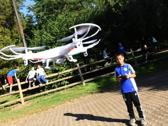 Nine-year-old Toi Murai controls a drone during a workshop