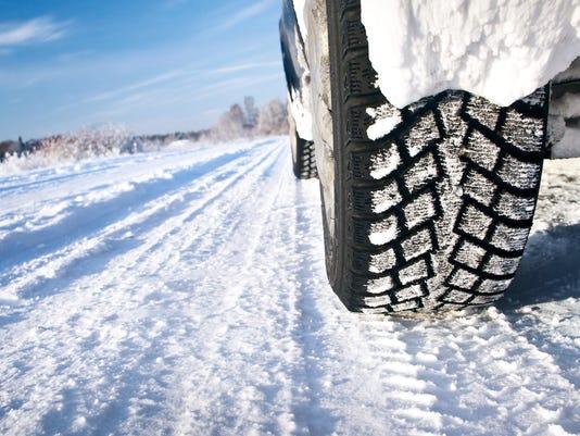 Closeup of car tires in winter morning