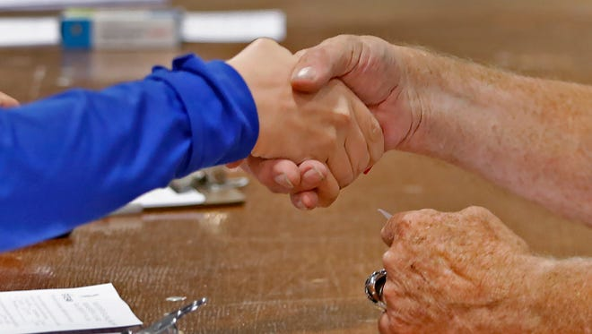 An interviewer shakes hands with an applicant after an interview during the ninth annual Indiana State Fair Job Fair, Tuesday, May 30, 2017. Hundreds of positions are available at the fairgrounds for people to apply for, but people can also come to the employment office to apply.