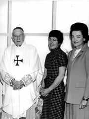 Bishop James Kearney with two unidentified women at St. Mary's Hospital. (Hand out photo, 2/4/1971)