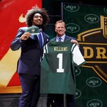 USC defensive lineman Leonard Williams poses with NFL commissioner Roger Goodell after being selected by the New York Jets as the sixth pick in the first round of the 2015 NFL Draft.