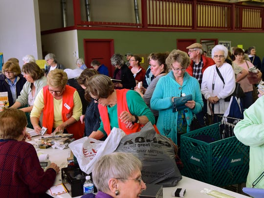 Patrons are in line to checkout at the 25th annual Salvation Army Women's Auxiliary Fabric Fair on Wednesday, May 4, 2016 at North Pointe Business Center. The popular three day event provides yarn, patterns and Christmas ornaments for patrons.