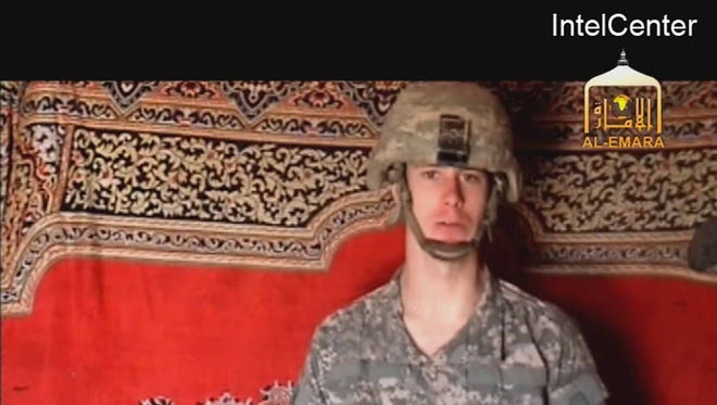 This is an image from video made available by IntelCenter shows a video frame grab from the Taliban propaganda video released Friday Dec. 25, 2009 purportedly showing U.S. soldier Pfc. Bowe Bergdahl, 23, of Ketchum Idaho who was captured more than five months ago in eastern Afghanistan.It could not be confirmed immediately that it was Bergdahl in the new video, which was released to The Associated Press and other news organizations. The man identifies himself as Bergdahl, born in Sun Valley, Idaho, and gives his rank, birth date, blood type, his unit and mother's maiden name before beginning a lengthy verbal attack on the U.S. conduct of the war in Afghanistan and its relations with Muslims. (AP Photo/via IntelCenter) IntelCenter Logo must not be cropped NO SALES ORG XMIT: NY114
