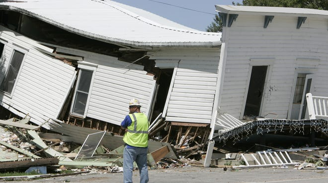 A worker surveys the damage at Pioneer Store in Ellison Bay after a July 2006 gas explosion