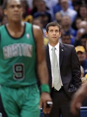 Celtics head coach and former Butler coach Brad Stevens can only look on as his team falls behind in the second half of Tuesday's game against Boston at Bankers Life Fieldhouse on Tuesday, March 11, 2014. The Pacers snapped a losing streak by beating the Celtics 94-83.