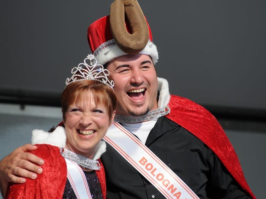 Justin Kendzierski and Carrie Marginet laugh after being crowned Bologna King and Queen. Times Herald in 2013.