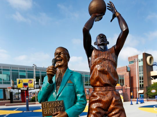 Slick Leonard and Reggie Miller are portrayed in one of the new bronze statues of iconic Indiana sports legends to be unveiled Tuesday, July 24, 2018, in the Riley Children's Health Sports Legends Experience area at the Children's Museum of Indianapolis.