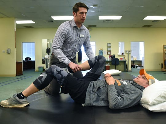 Benchmark physical therapist Chase Best works with Matthew Thompson during a session Thursday, March 22, 2018.