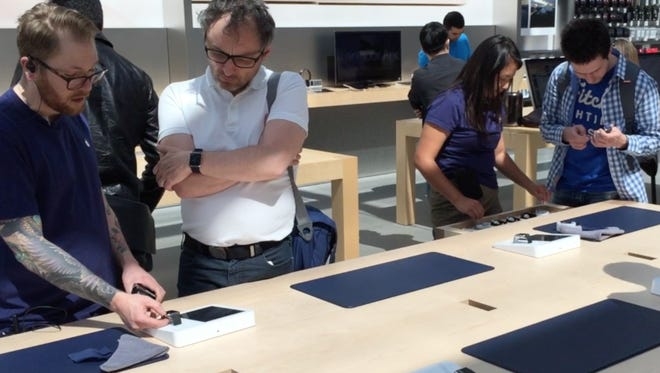Shoppers look at Apple Watch at Apple Store in Palo Alto