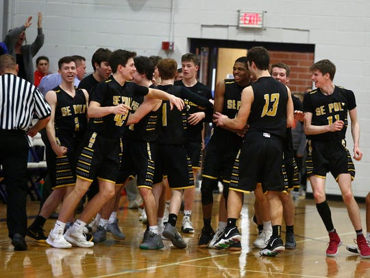 Southeast Polk players react to upsetting Indianola. Southeast Polk stunned Indianola 67-64 in a Class 4A substate quarterfinal in Indianola on Feb. 18.