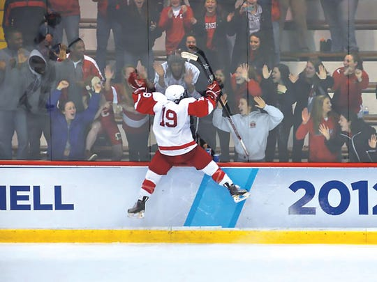 Leaping up, Jillian Saulnier celebrated the victory with the Lynah Faithful.
