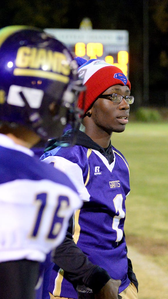 Waynesboro's Michael Brown watches the game from the