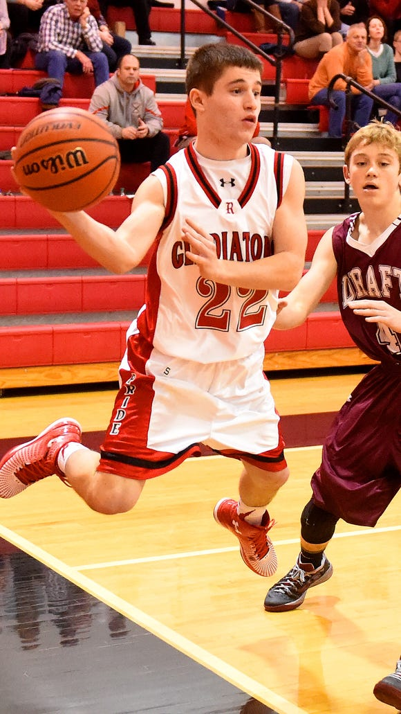Riverheads' Graham Cash gets to the ball and and passes it before it can be ruled out of bounds while Stuarts Draft's Carson Peck guards during a basketball game played in Greenville on Thursday, Jan. 15, 2015.