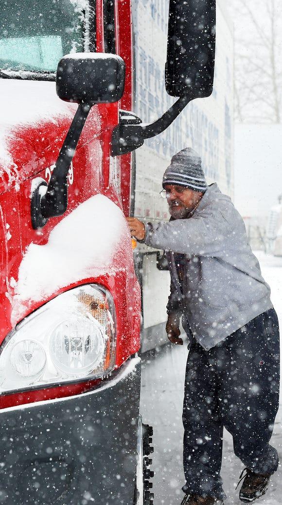 Snow falls as long distance truck driver Florin Dumitru