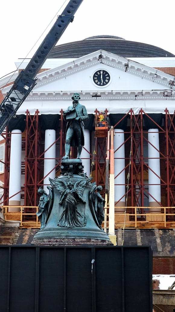 The Rotunda with scaffolding surrounding it and a statue