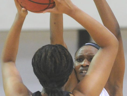 ACU's Taudenciah Oluoch, right, defends against Stephen