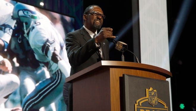 Former Seattle Seahawks safety Kenny Easley announces that the Seahawks selects Michigan defensive lineman Frank Clark as the 63rd pick in the second round of the 2015 NFL Football Draft,  Friday, May 1, 2015, in Chicago.