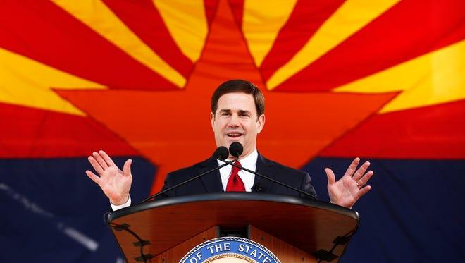 Arizona Gov. Doug Ducey speaks after he is sworn in on Monday, Jan. 5, 2015,