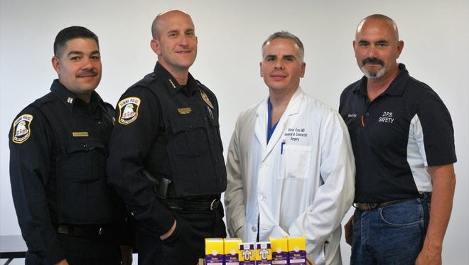 Pictured left: Deming Police Captain Alex Valdespino, Chief Bobby Orosco, Dr. Victor Cruz, and Mayor Benny Jasso, celebrated the arrival of 35 Evzio naloxone injection kits on Monday, Oct. 30.