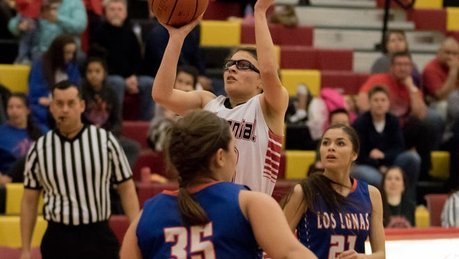 Centennial's Megan Teran one hands a shot against Los Lunas Tuesday night at Centennial High School.
