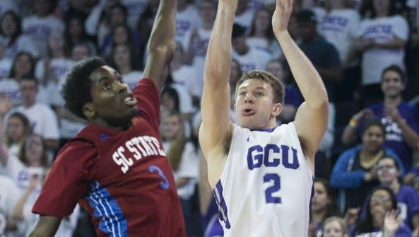 GCU's Joshua Braun (2) makes a 3-pointer over SC State's