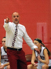 First-year head coach Scot Dailey yells out direction to Worcester Prep against Broadwater Academy on Monday, Nov. 30.