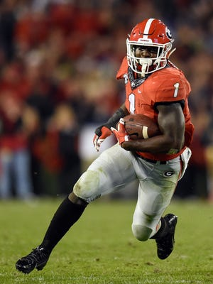 Georgia Bulldogs running back Sony Michel (1) runs against the Georgia Southern Eagles during the second half at Sanford Stadium. Georgie defeated Georgia Southern 23-17 in overtime.