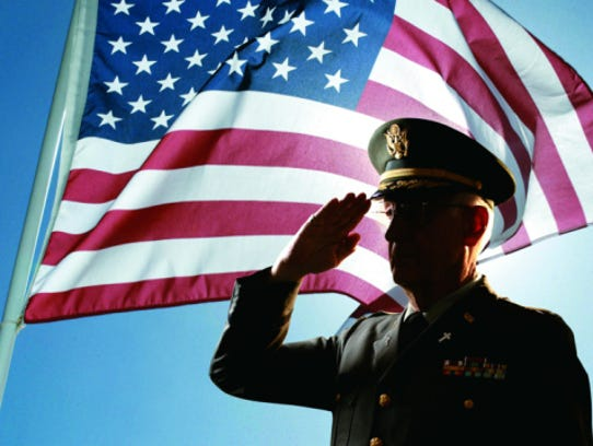 Photo, silhouette of senior military chaplain saluting