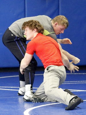 Elmira's Charlie Mahon, front, trains with Chris Eames of Horseheads on Wednesday during a combined practice session at Horseheads High School.
