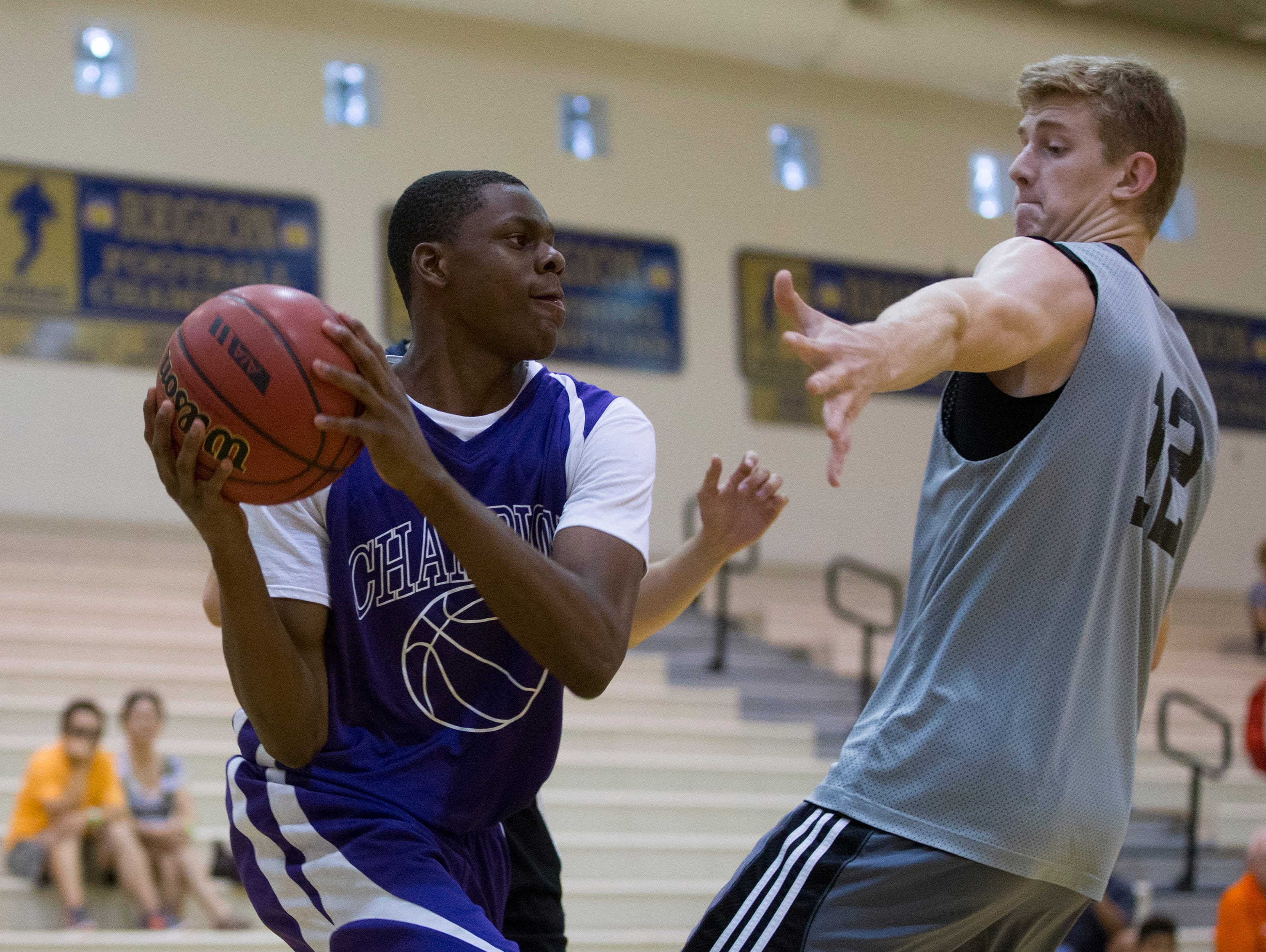 Malik Porter of Cesar Chavez looks to pass while being guarded by Highland High's Tim Fuller during Best in Basketball Summer Invitational at Sandra Day O'Connor High School in Phoenix on June 26, 2015.