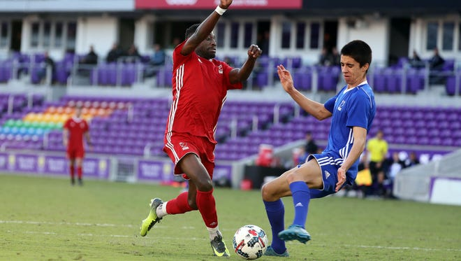 Team Predator defender Mark Segbers, left, dribbles the ball as Team Tango defender Joao Moutinho defends during the second half of the second game of the 2018 MLS Player Combine at Orlando City Stadium in Orlando, Fla.