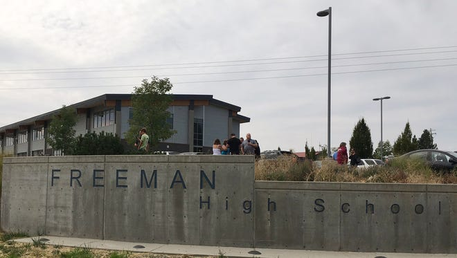 People gather outside of Freeman High School after reports of a shooting at the school in Rockford, Wash.,Sept. 13, 2017.