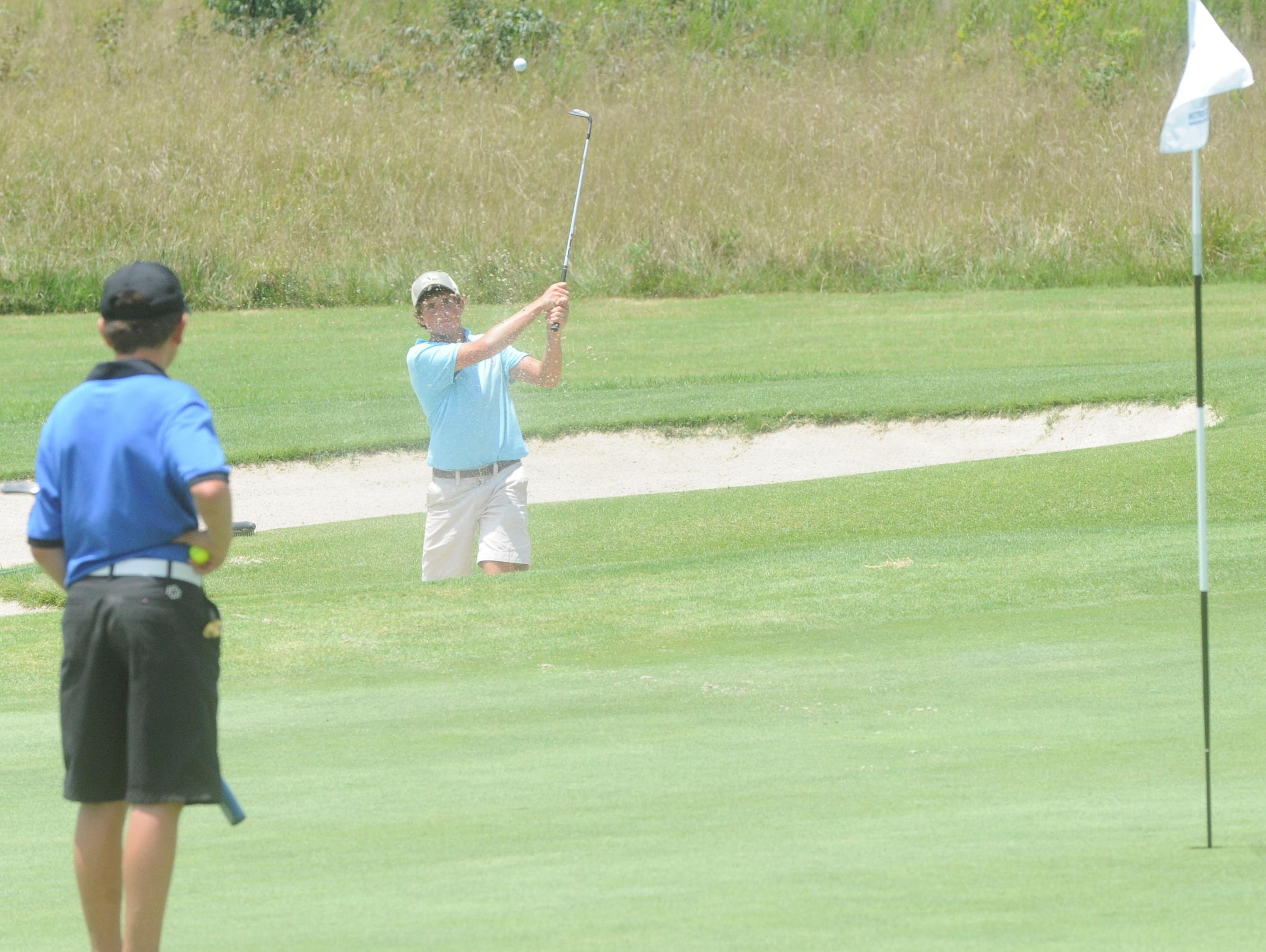 Mountain Home's Ben Hagaman blasts a shot out of the bunker on the fifth hole at Big Creek Golf & Country Club during the Chuck Morton Memorial Junior Golf Tournament on Friday.