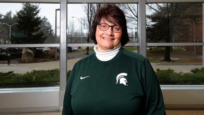 MSU Alumni Association's Sue Petrisin in the lobby of Spartan Stadium Dec. 18. Petrisin, MSUAA's associate director for alumni programs, recently began her term as the first woman president of Kiwanis International.