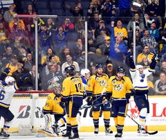 Feb 2, 2016; Nashville, TN, USA; St. Louis Blues right winger Troy Brouwer (36) and St. Louis Blues center Paul Stastny (26) celebrate after scoring the game-winning goal during the third period at Bridgestone Arena. The Blues won 1-0. Mandatory Credit: Christopher Hanewinckel-USA TODAY Sports