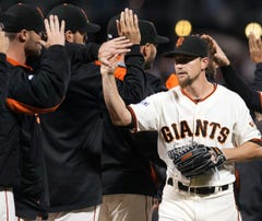 Sep 30, 2015; San Francisco, CA, USA; San Francisco Giants starting pitcher Mike Leake (13) high fives team mates after defeating the Los Angeles Dodgers 5-0 at AT&T Park. Mandatory Credit: Ed Szczepanski-USA TODAY Sports